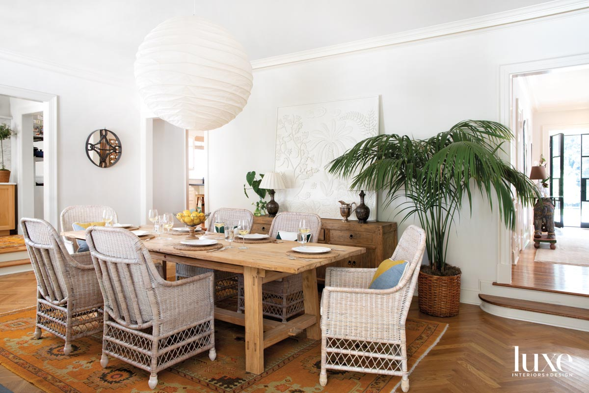 Dining room with wicker chairs,...