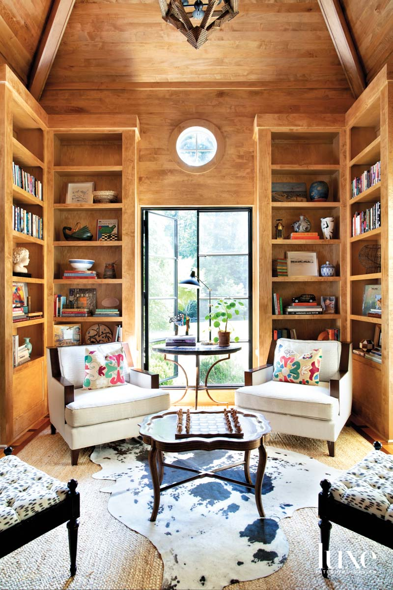 Wood paneled library with round...
