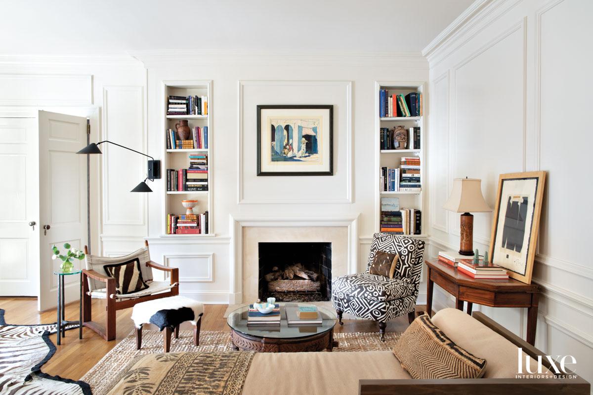 Sitting room with built-in bookshelves,...