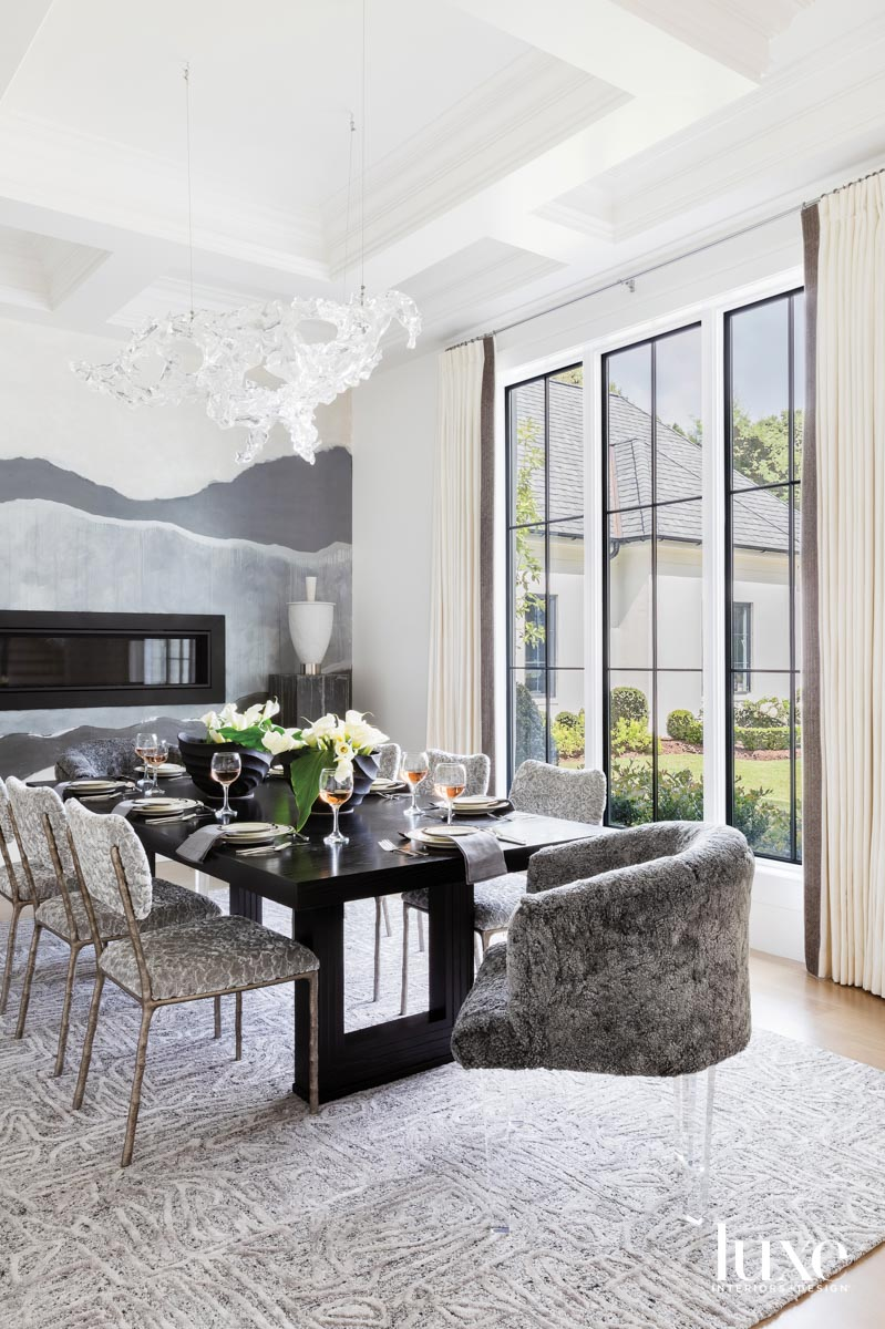 Dining room with large windows,...