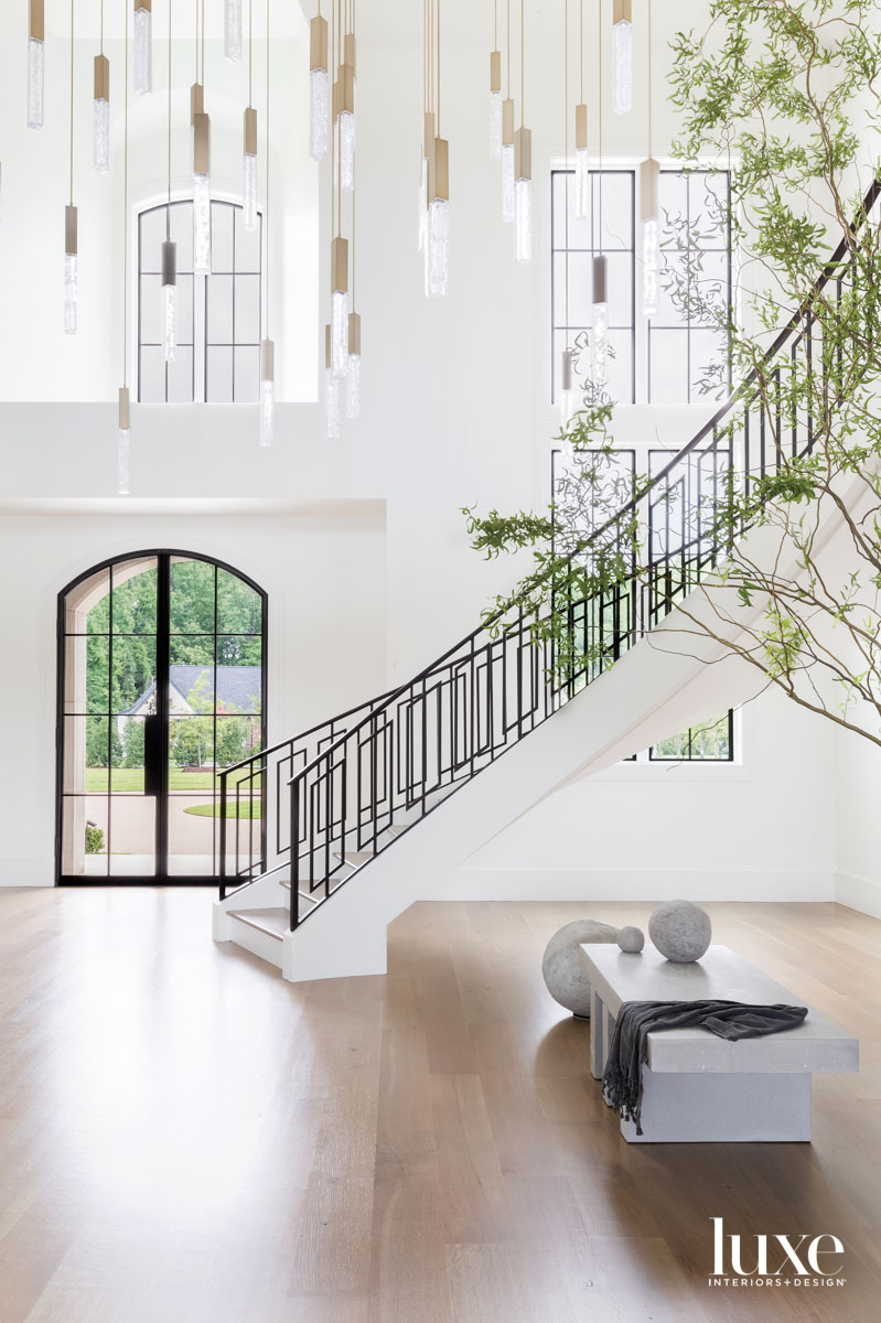 Vast entryway with spiral staircase,...