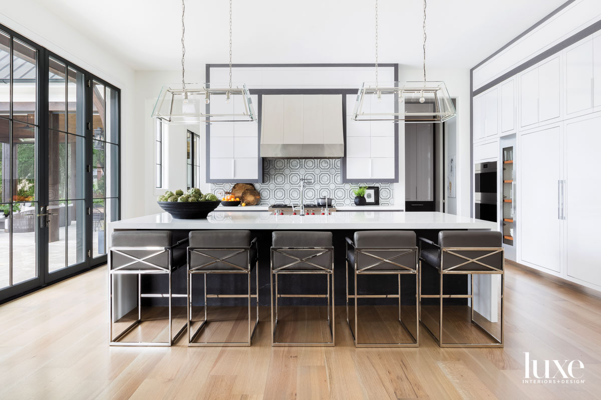 Kitchen with white cabinetry, gray...