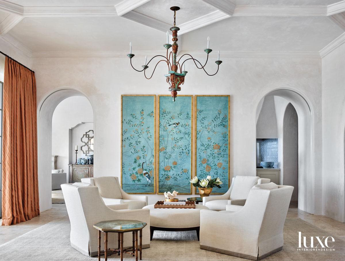 Living room with framed aqua...