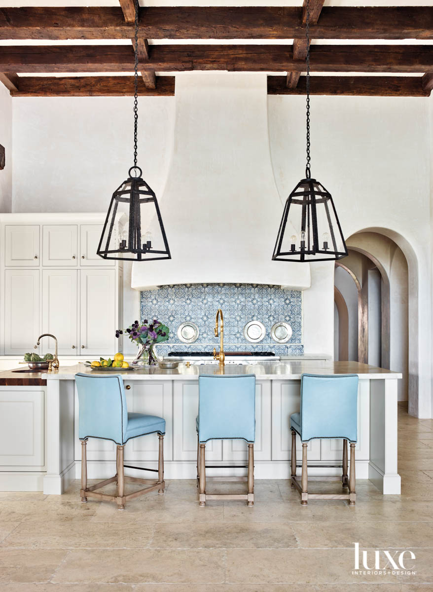 Airy kitchen with blue tile...
