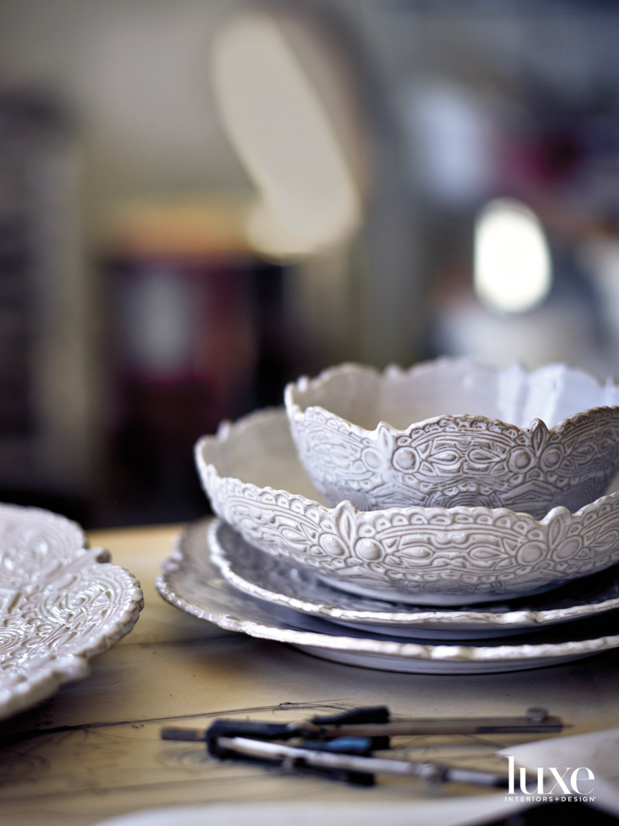 White-glazed plates and bowls stacked on a table