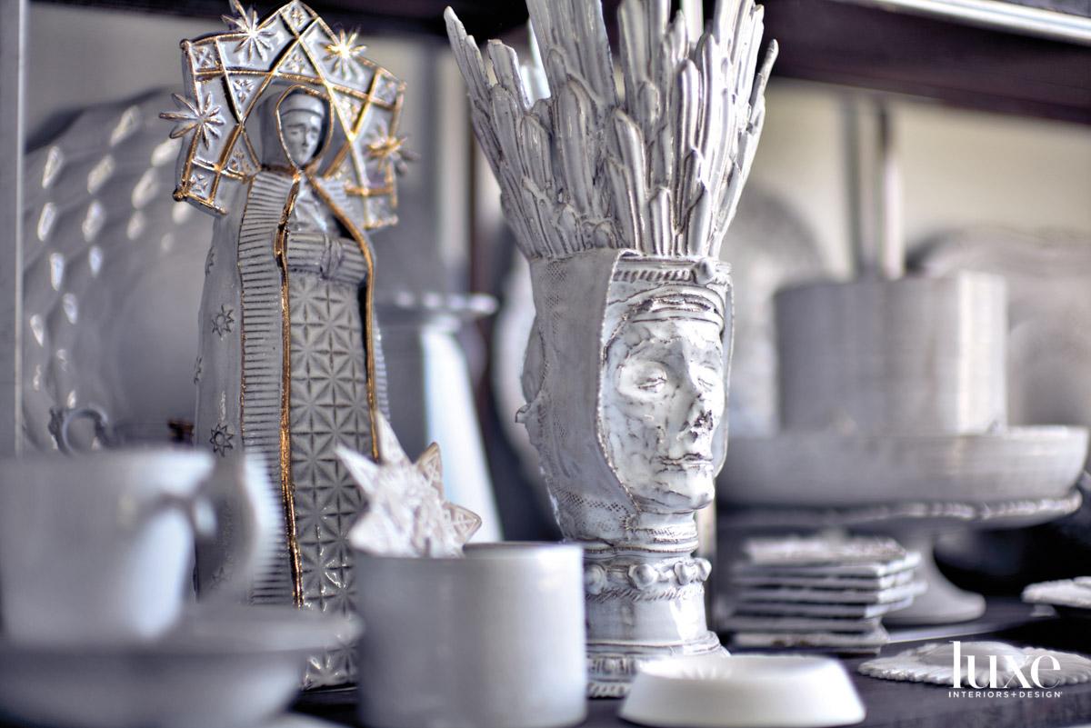 White ceramic works featuring female figure.