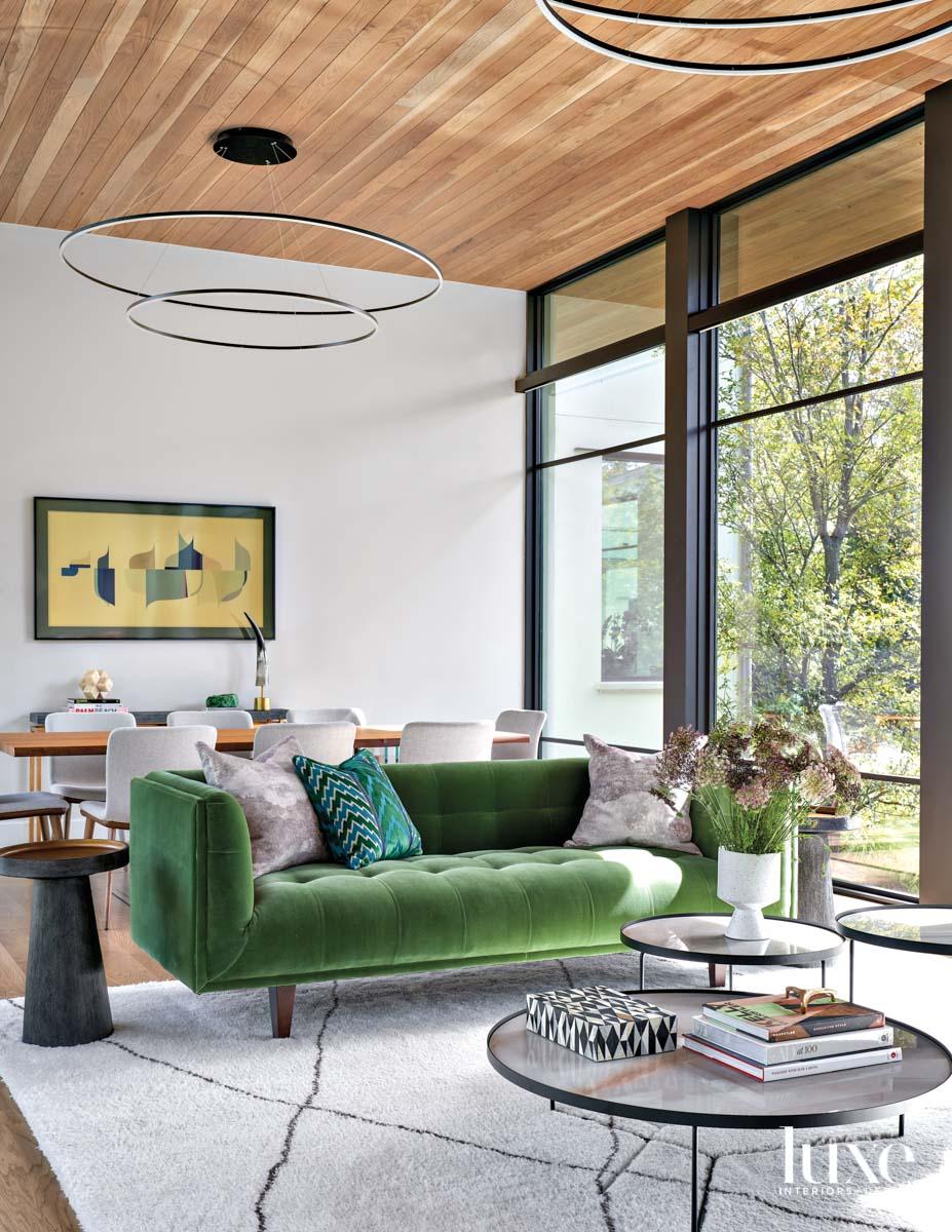 green velvet sofa with trio...