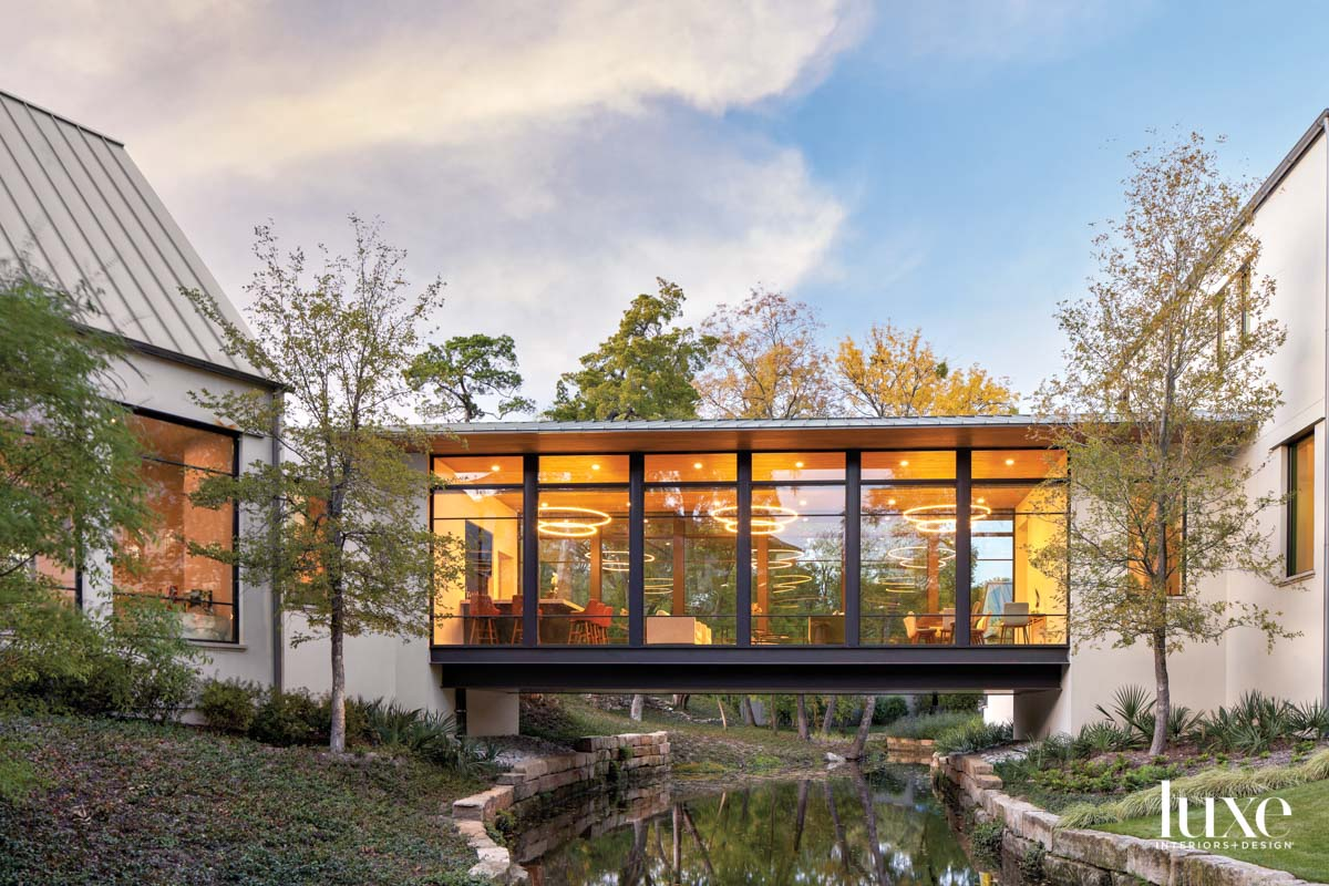 glass house exterior with creek
