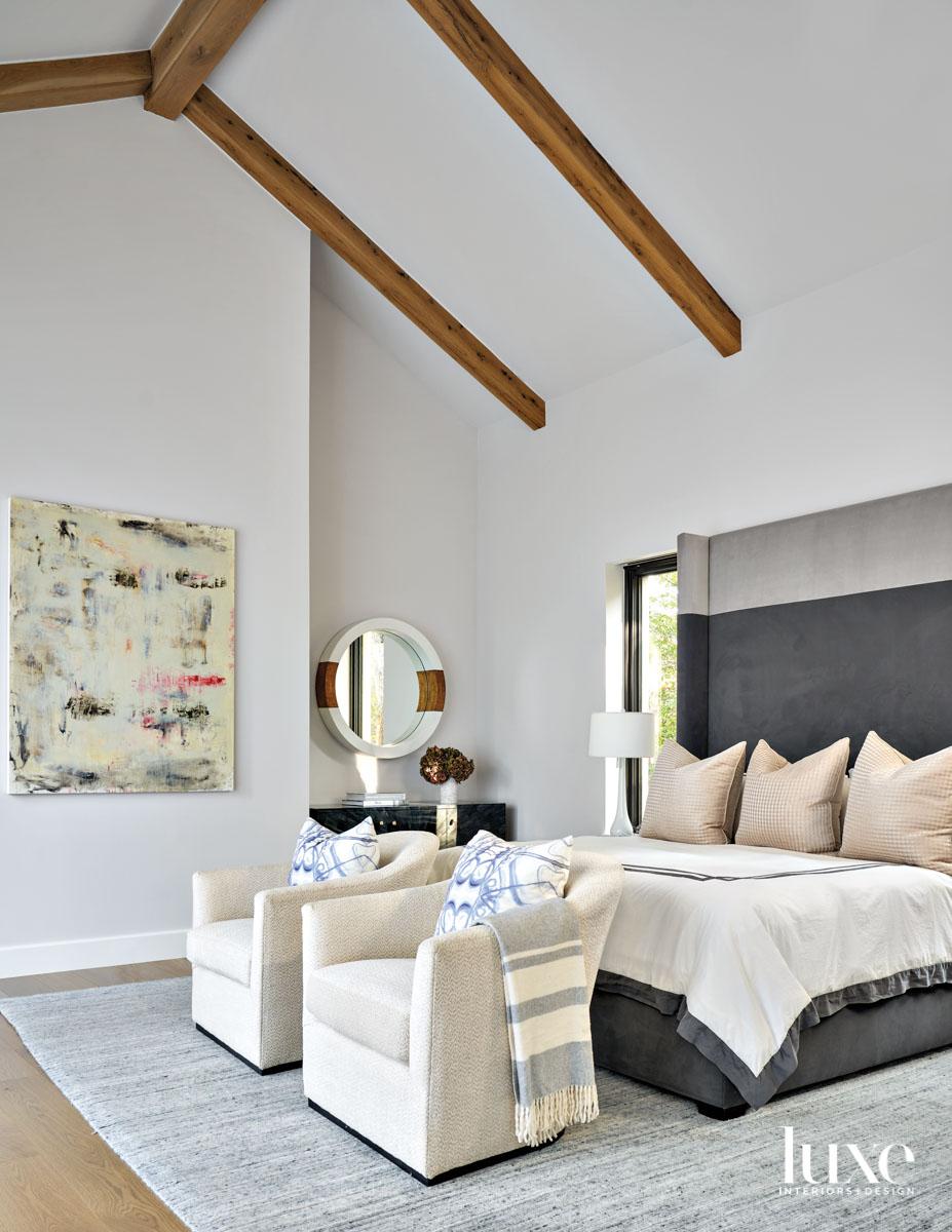 white bedroom with gray velvet...