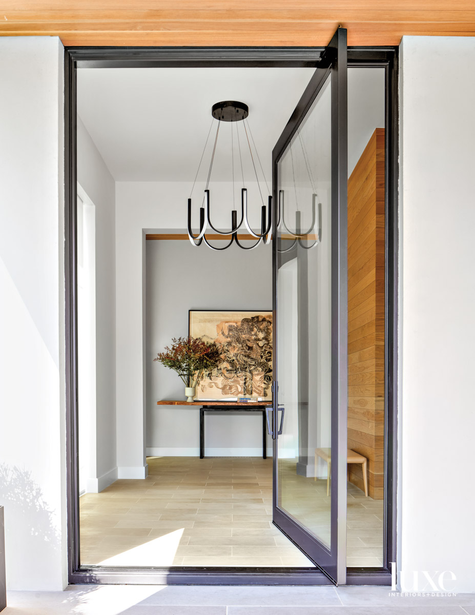 entry with glass door and...