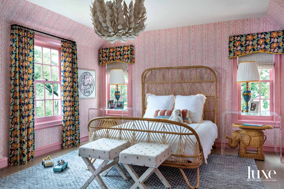Colorful girl's bedroom with wallpaper...