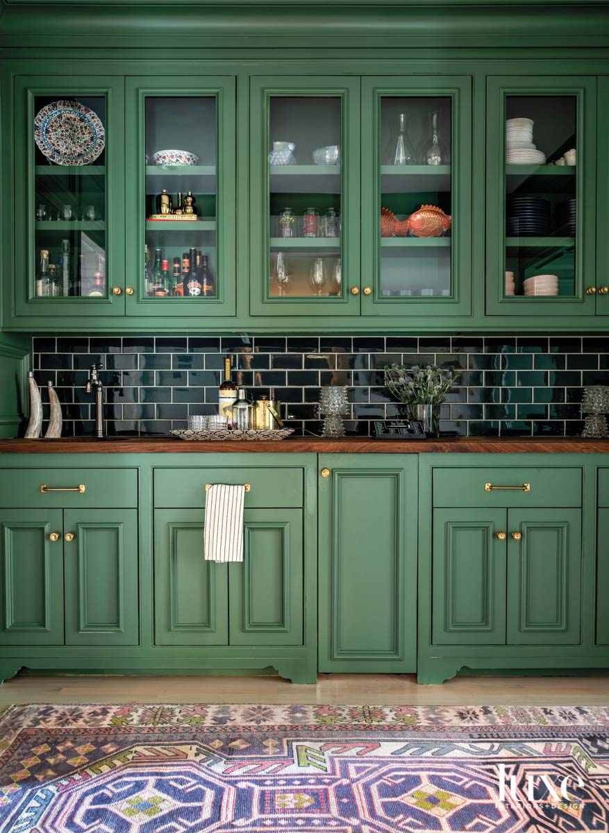 Butler's pantry with green cabinetry