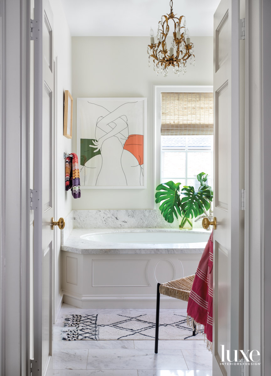 Classic white main bathroom with...