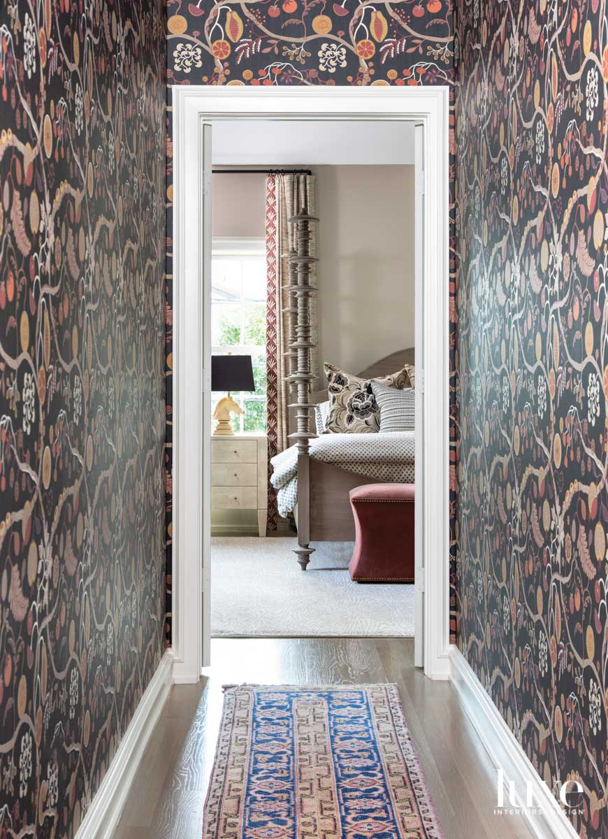 Wallpapered hallway leading to a...