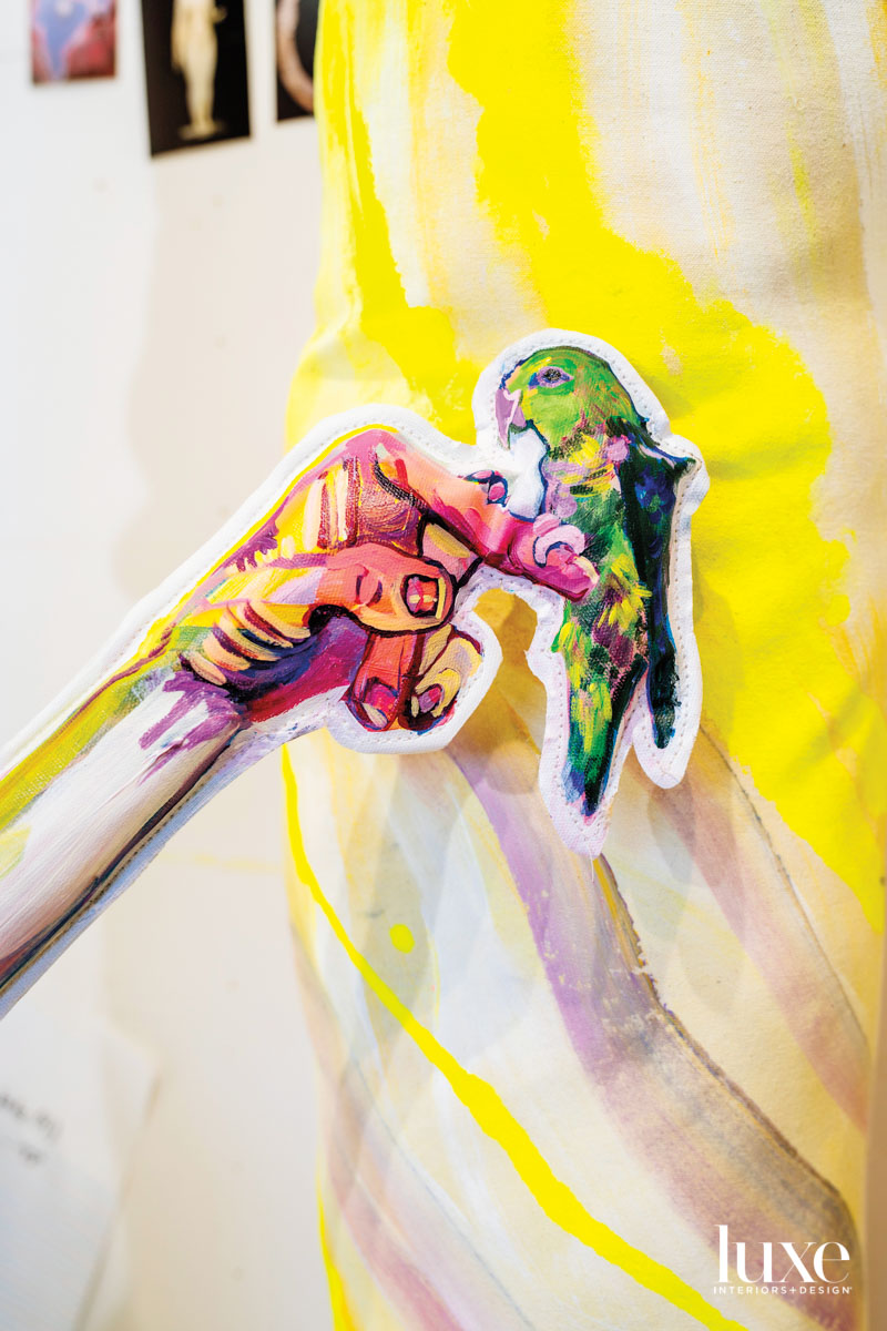 3D painting of a hand holding a bird