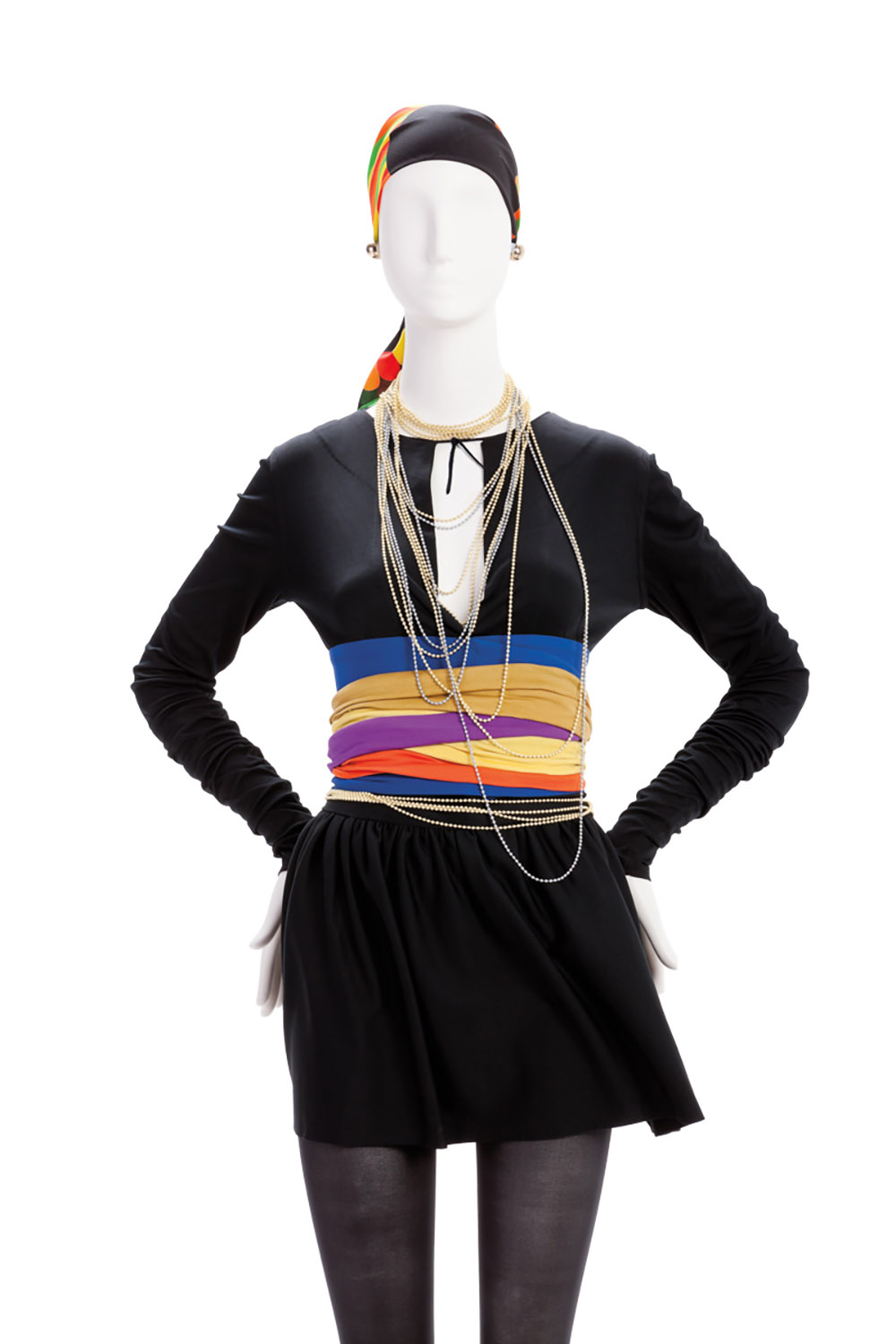 Black dress with long sleeves and multi-color ties at waist.