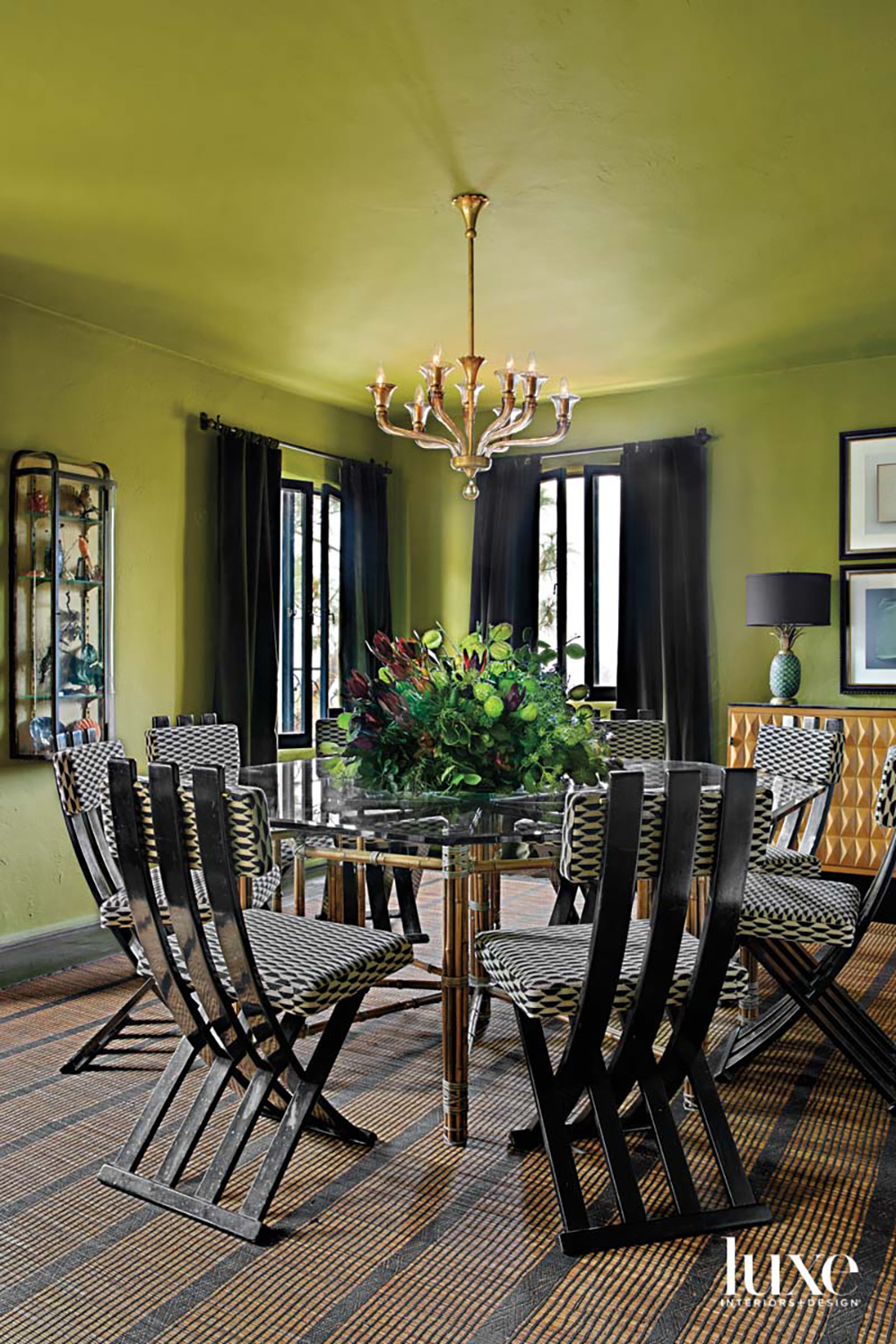 Green dining room with round...