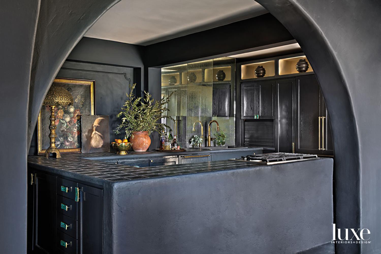 Dark gray painted kitchen with...