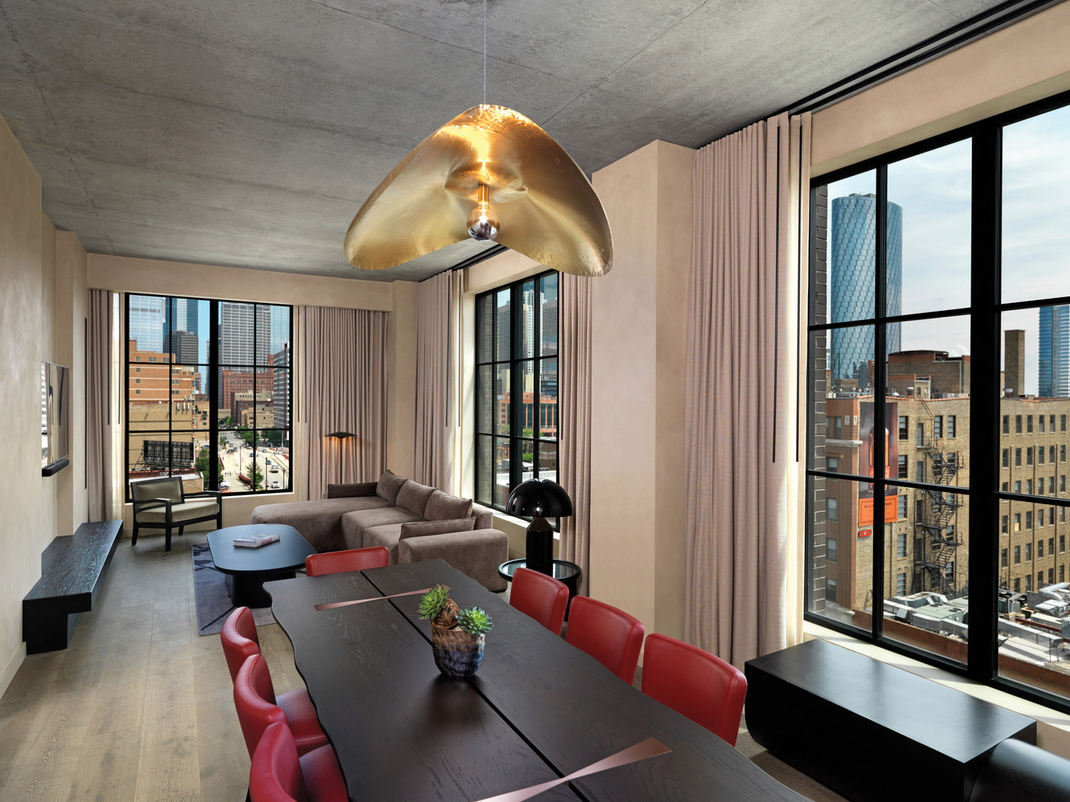 Dining table with red chairs in hotel suite
