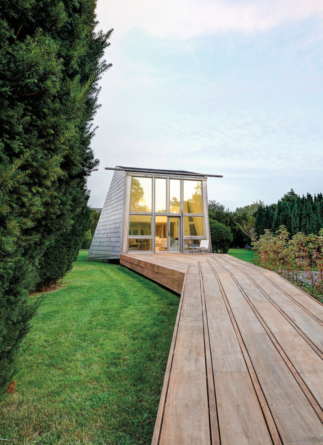 wooden walkway to glass structure