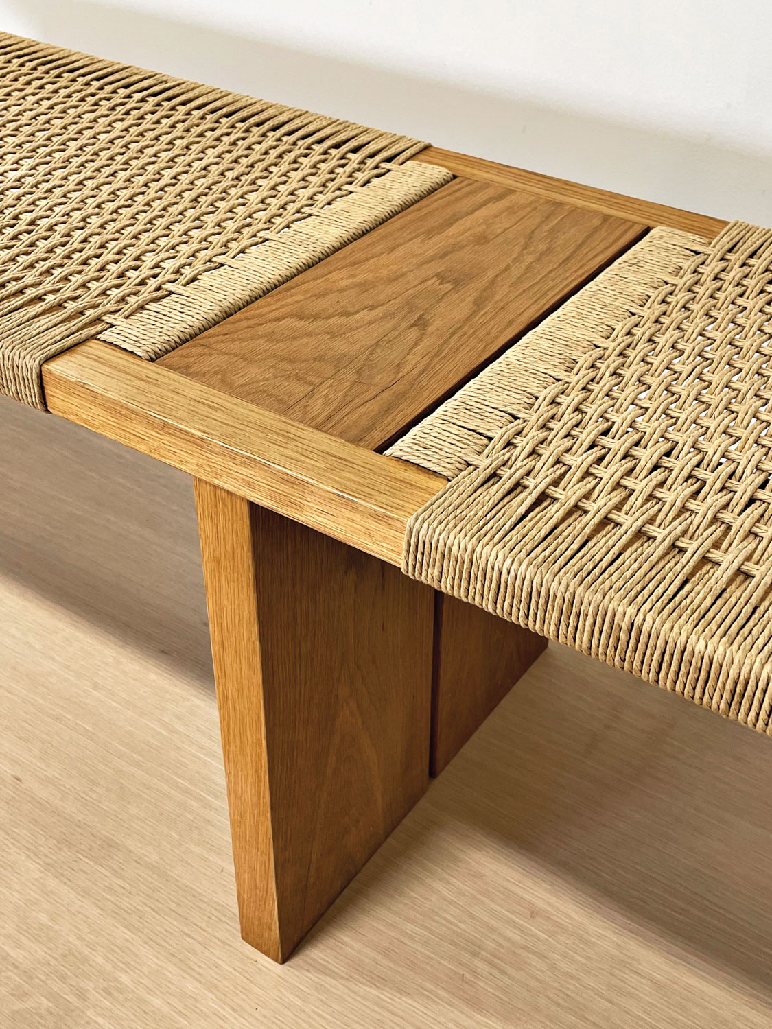 Wooden bench with weaving