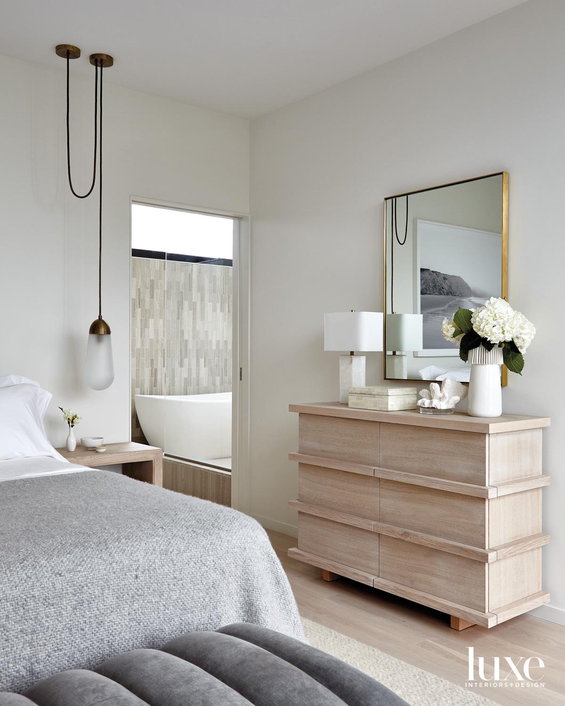 grey linen bed with dresser