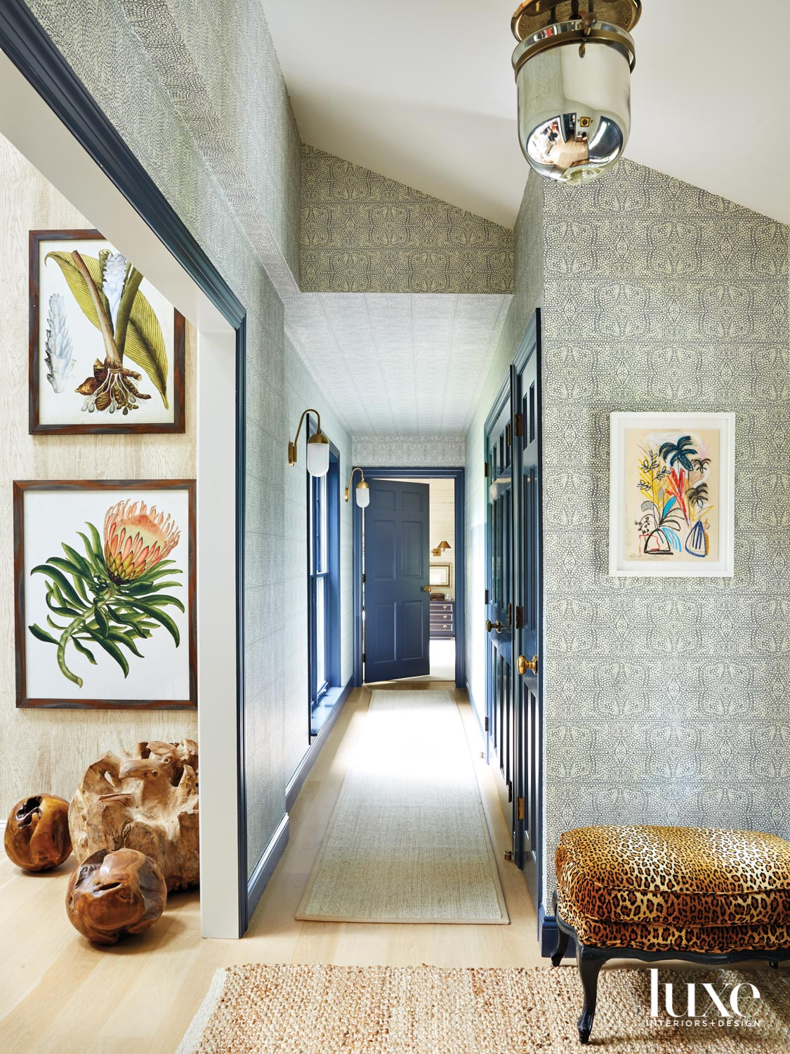 Wallpapered hallway with antique accents