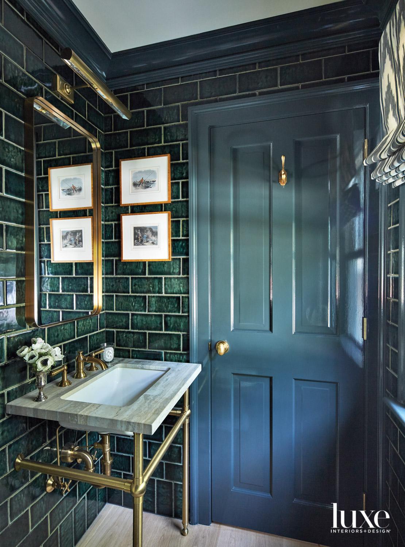 Dark green tiled bathroom with...