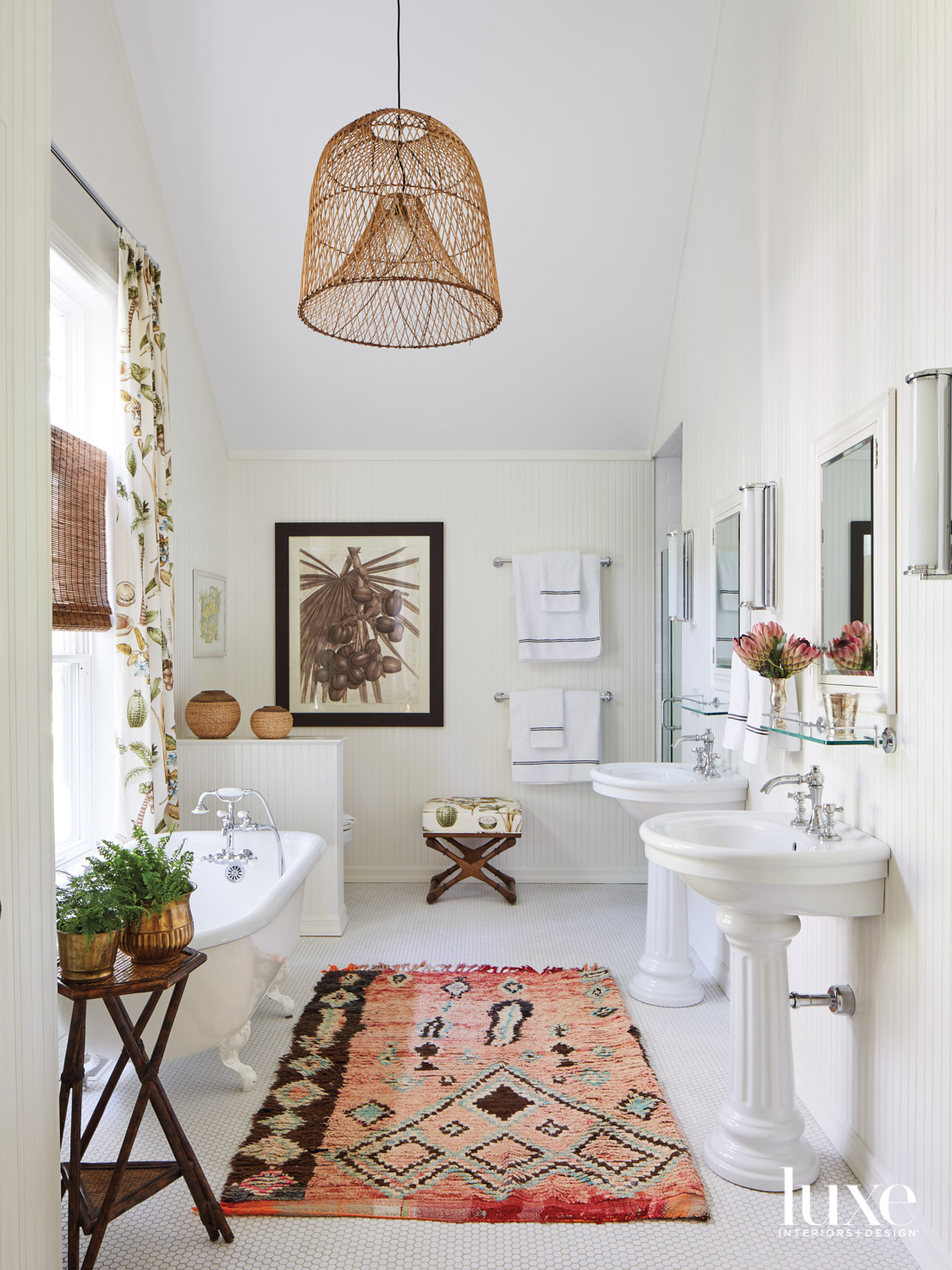White tiled bathroom with vintage...