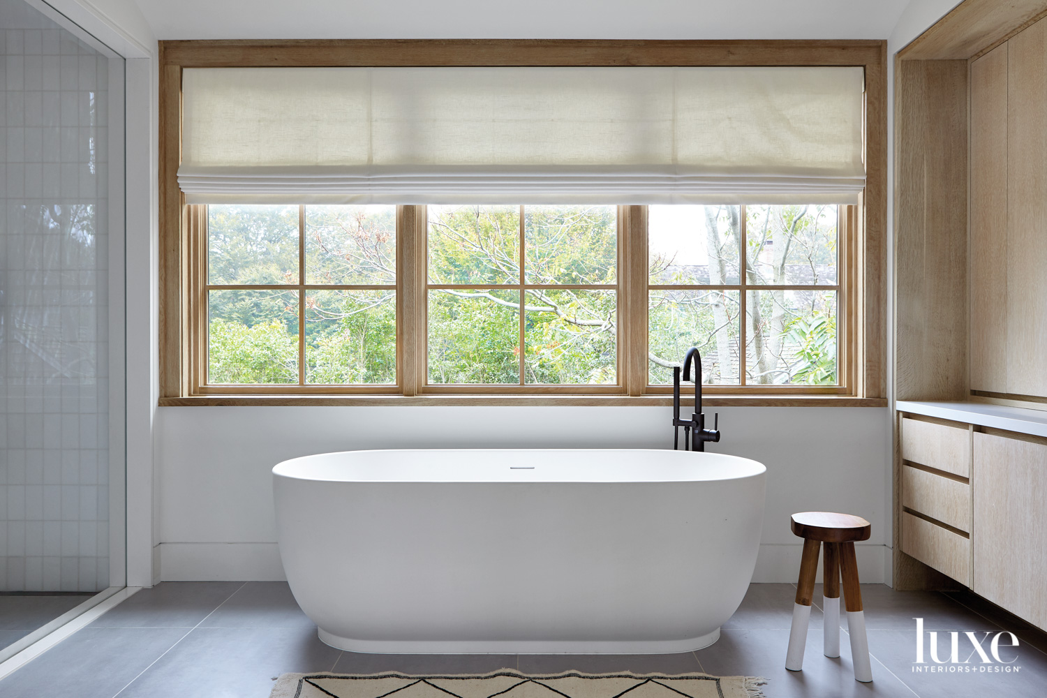 White soaking tub in front...