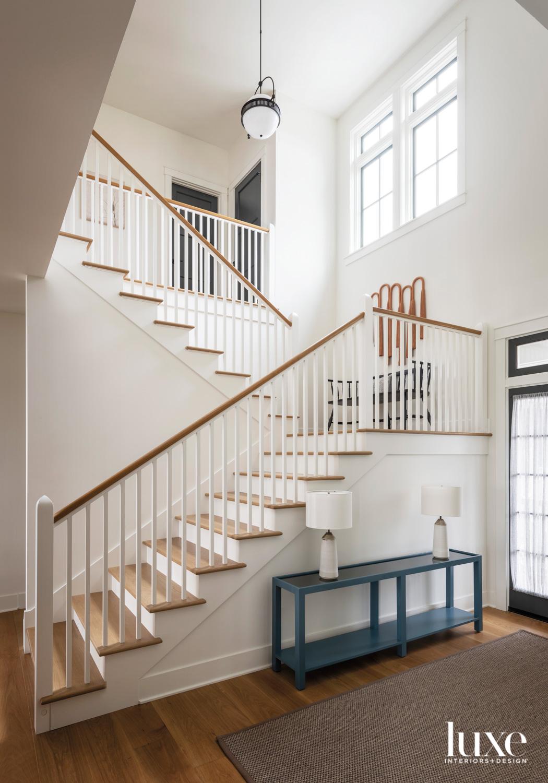 white staircase entryway
