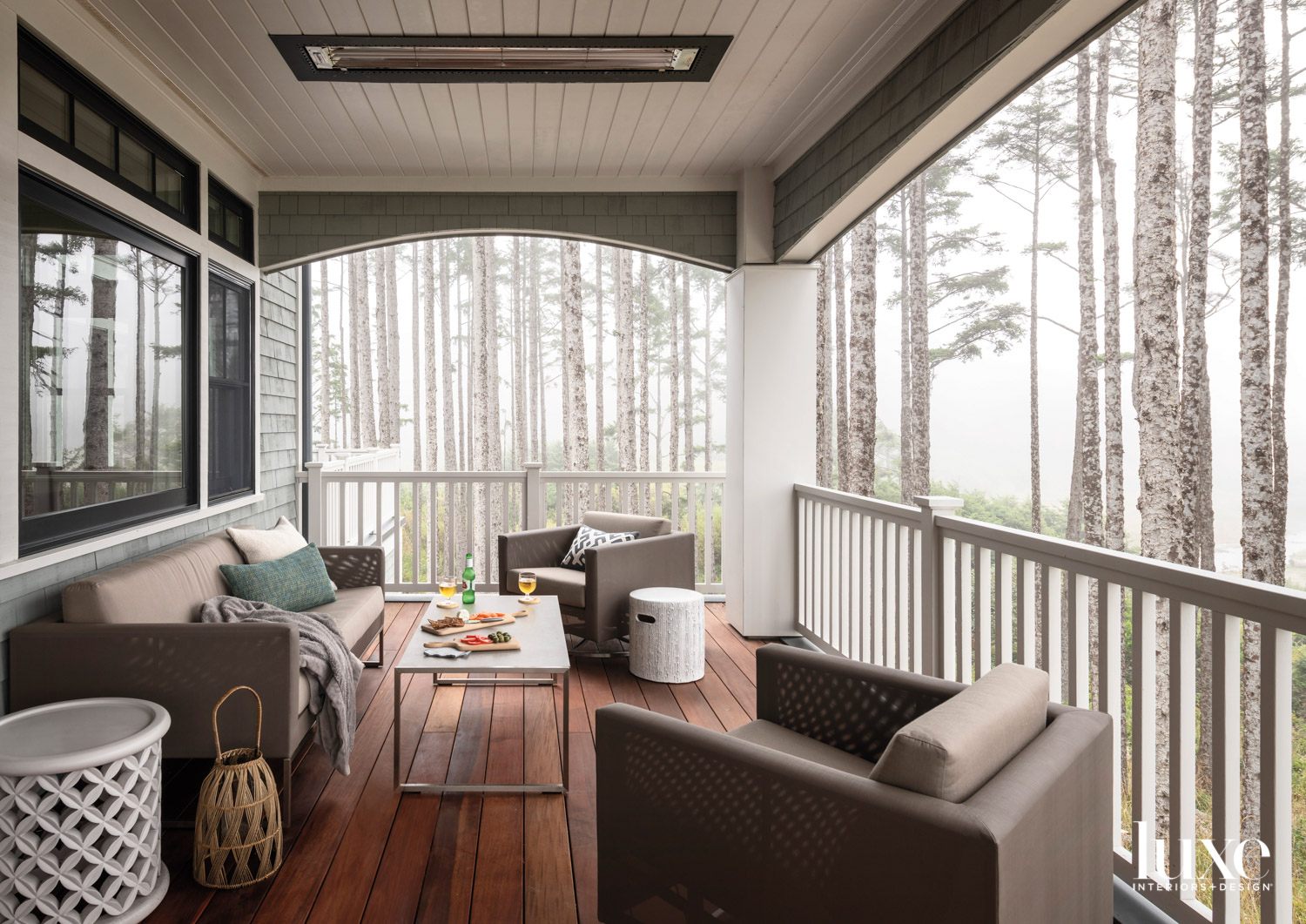 Covered outdoor porch with sofa...