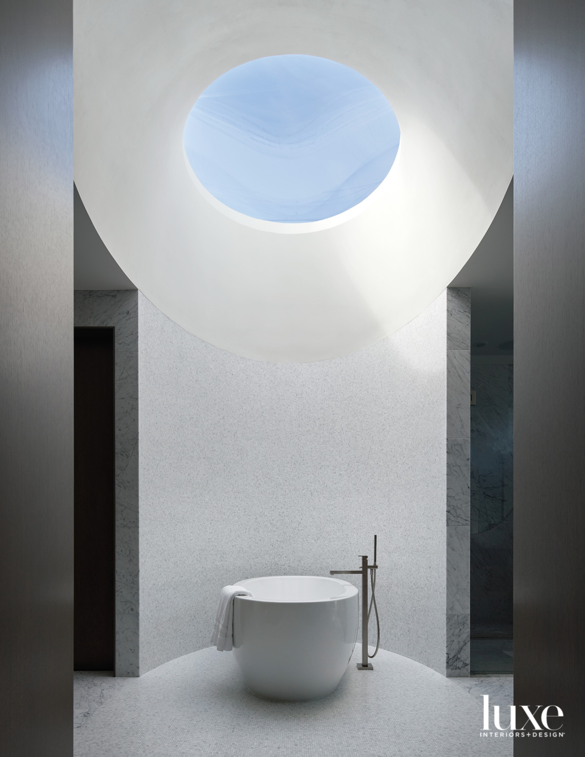 primary bathroom with oculus above a freestanding tub