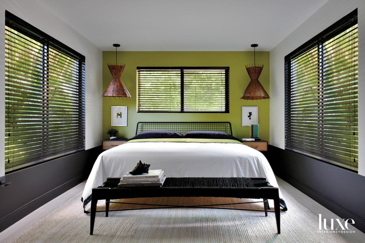 bedroom with green wall, white...