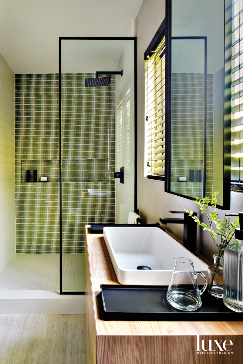bathroom with green tile shower,...