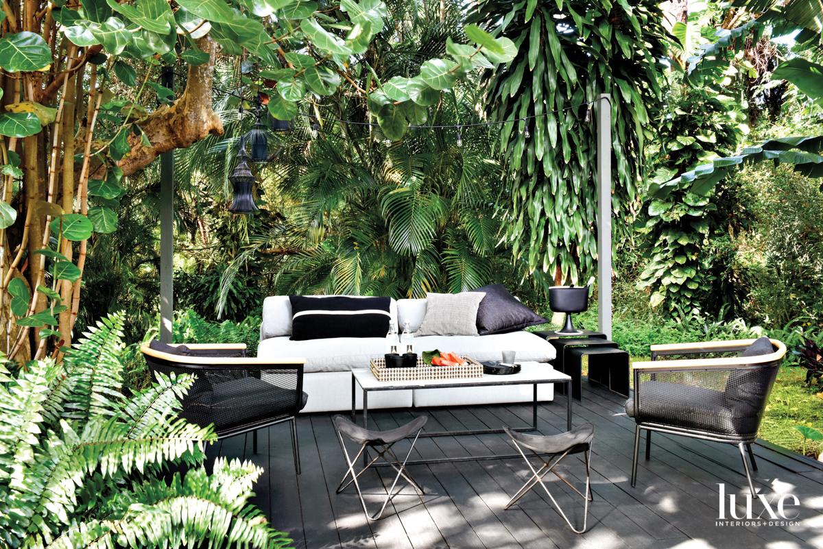 black deck with white sofa,...