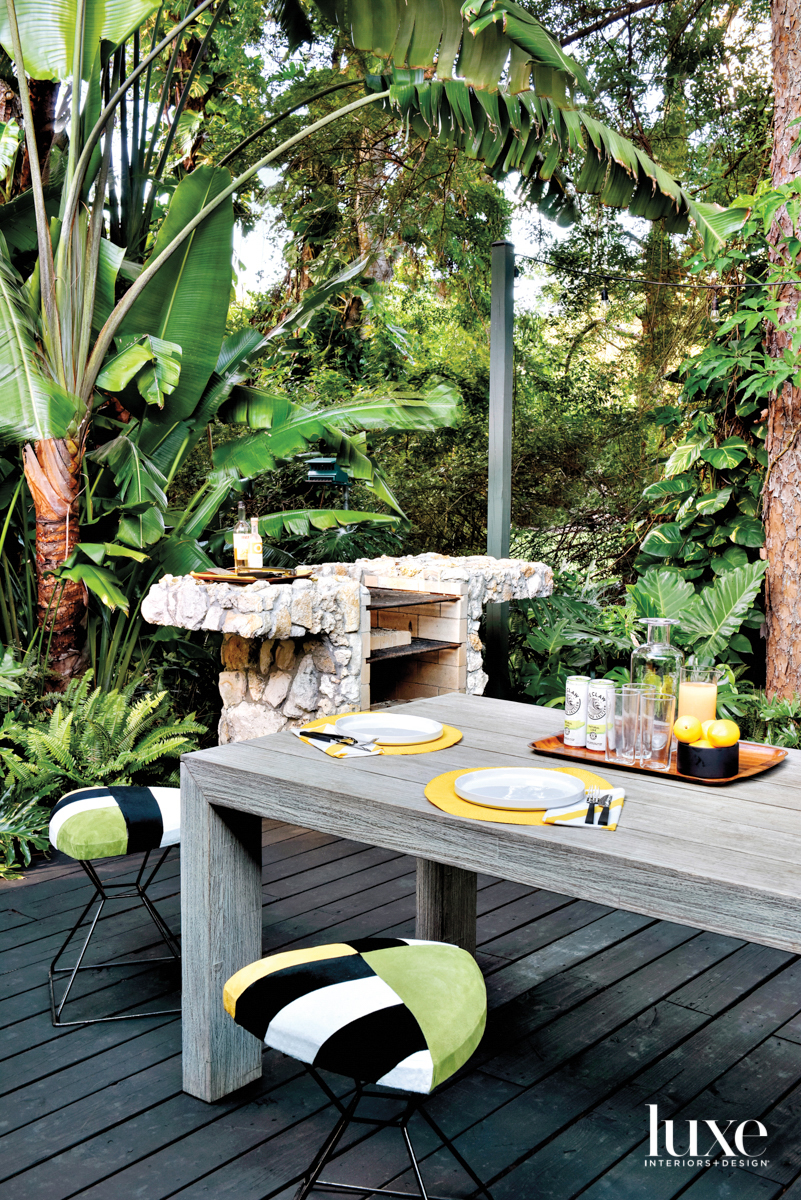 back deck with wood dining...