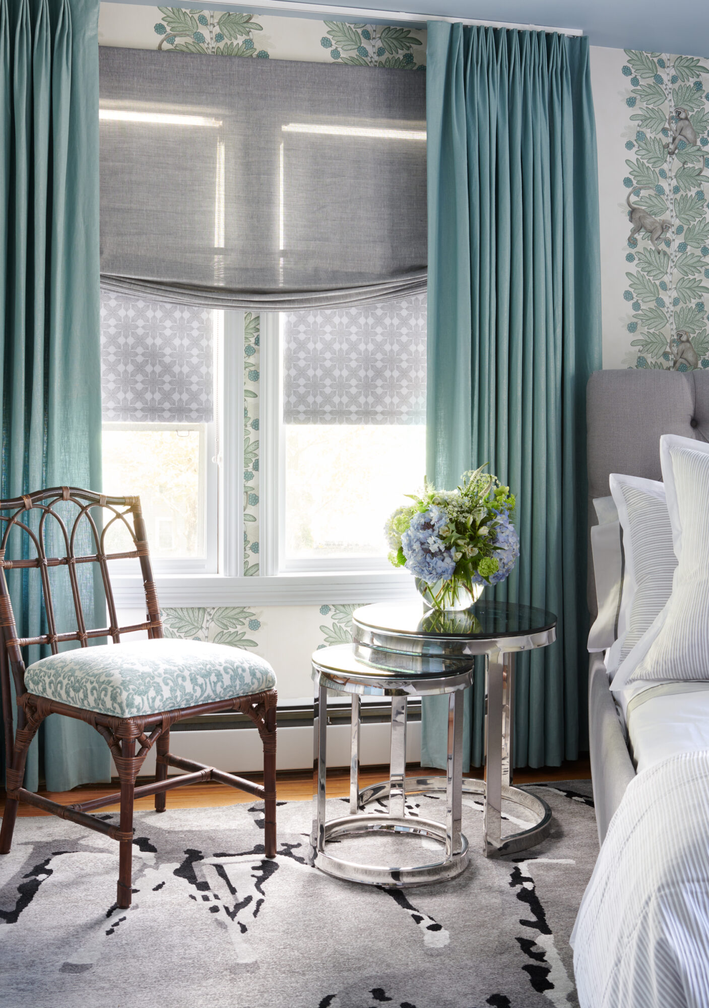 teal and gray bedroom with accent chair