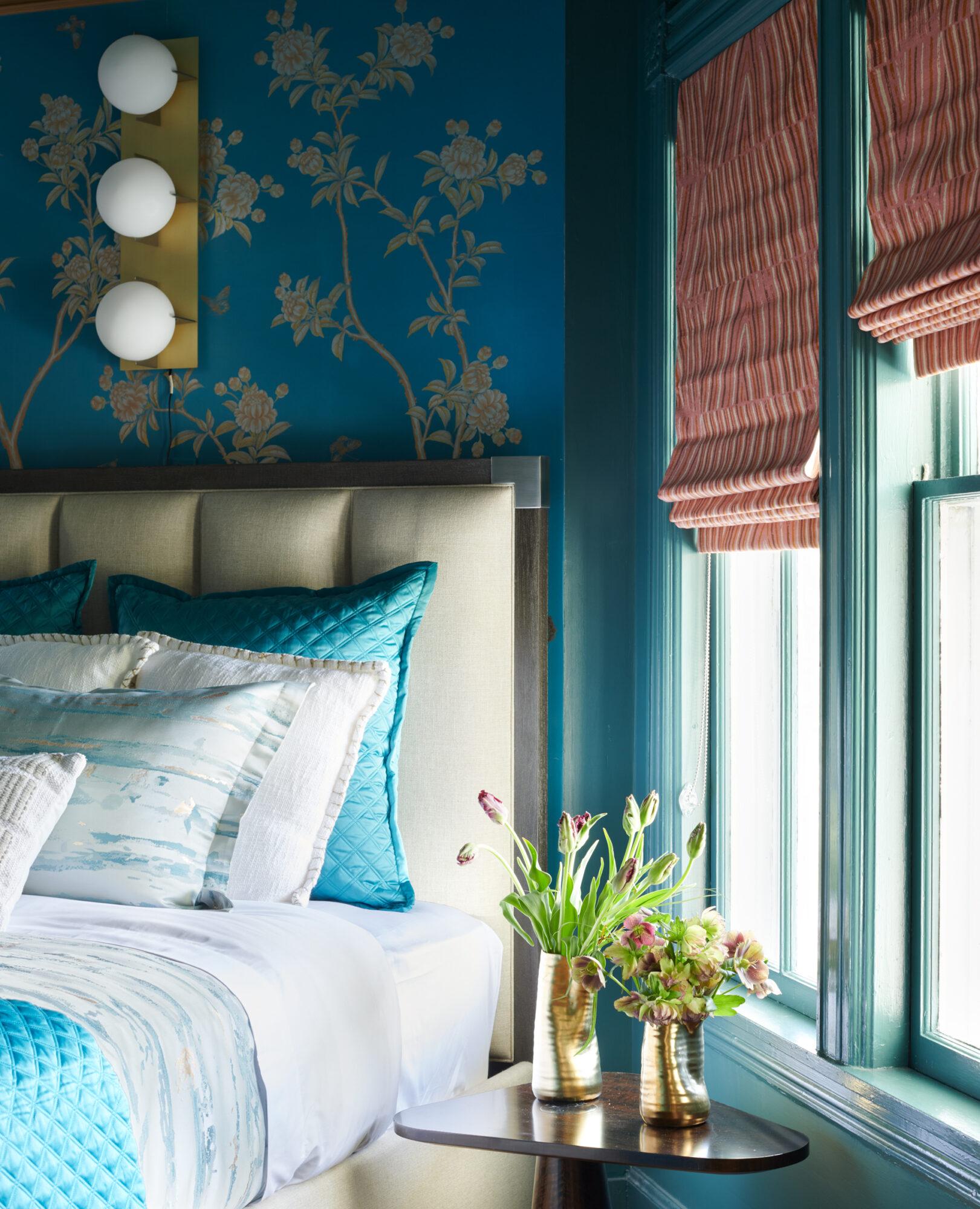 blue floral bedroom with orange shades