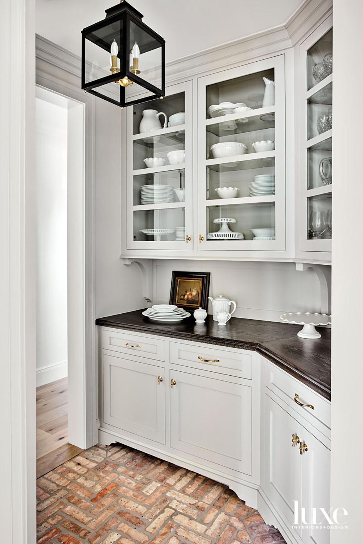 A white pantry has white...