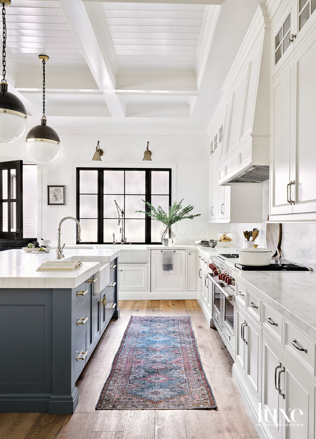 A white kitchen with a...