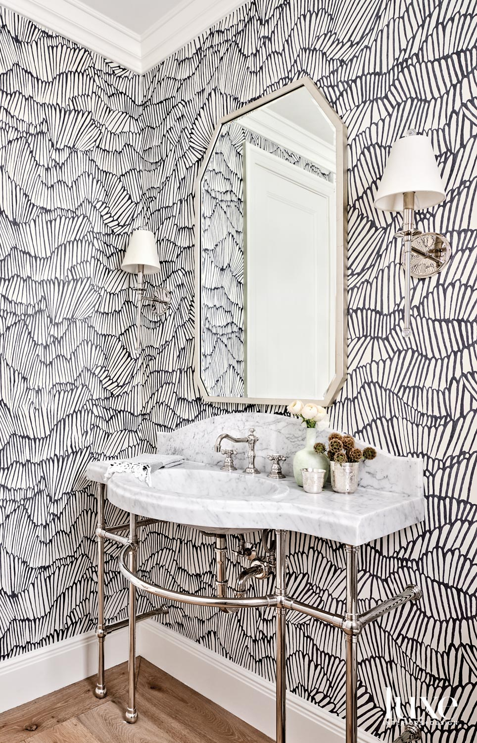 A powder room with black-and-white...