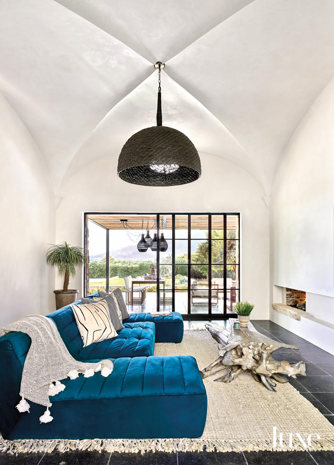A turquoise sofa with two...