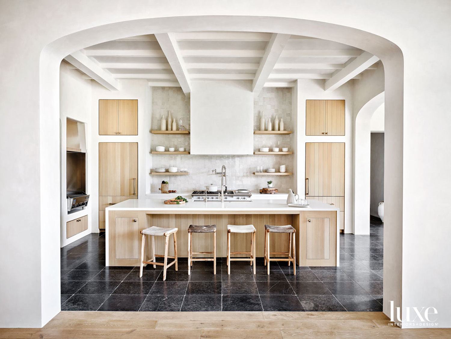 A light-wood-and-white kitchen with cowhide...