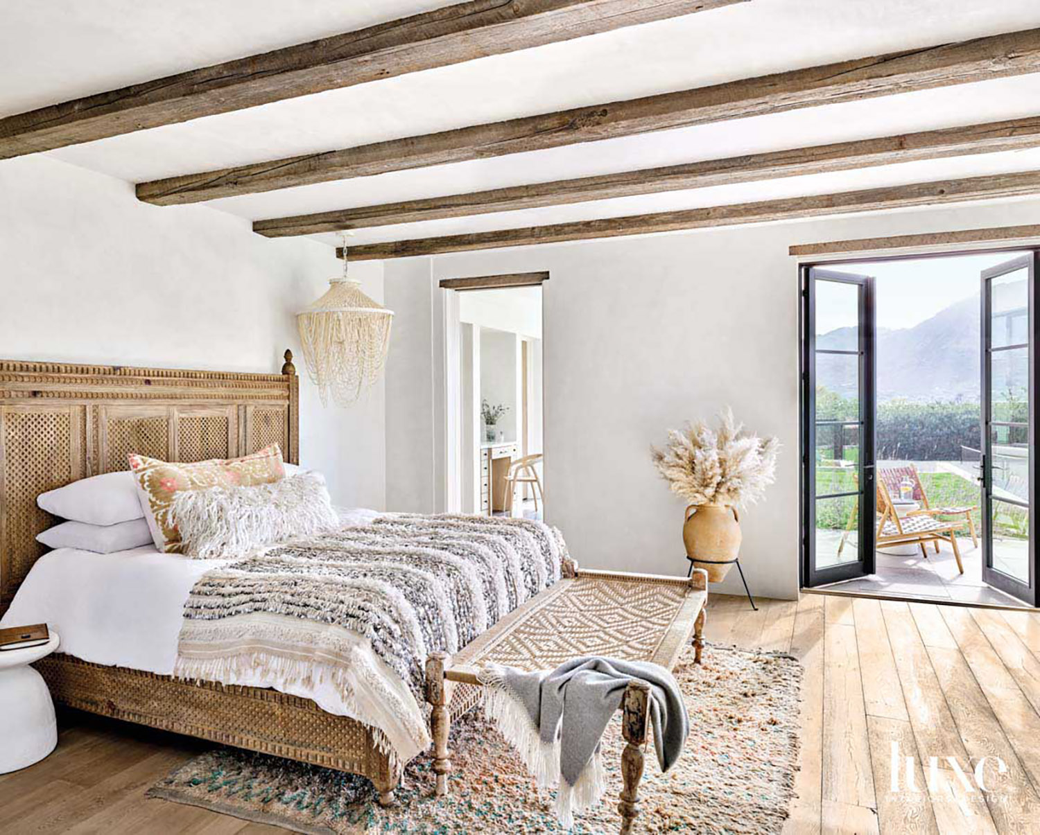 A carved wooden bed has...