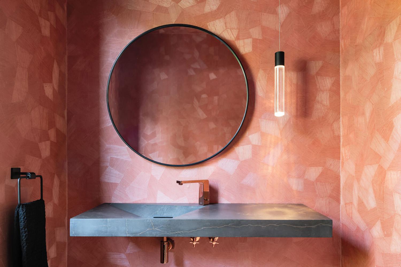 pink powder bath with round mirror