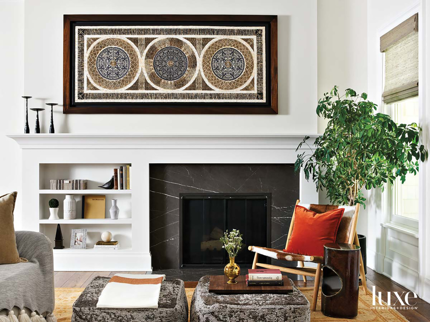 A black stone fireplace with...