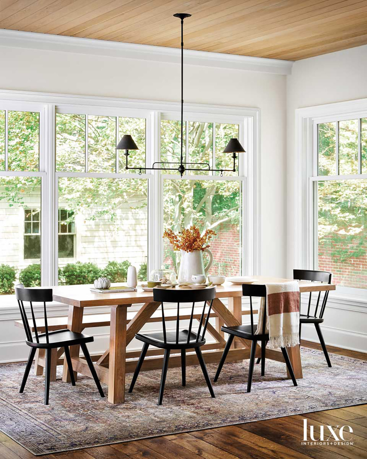 A wood dining table surrounded...