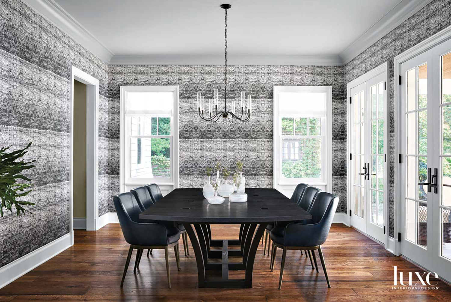 A dining room with black-and-white...