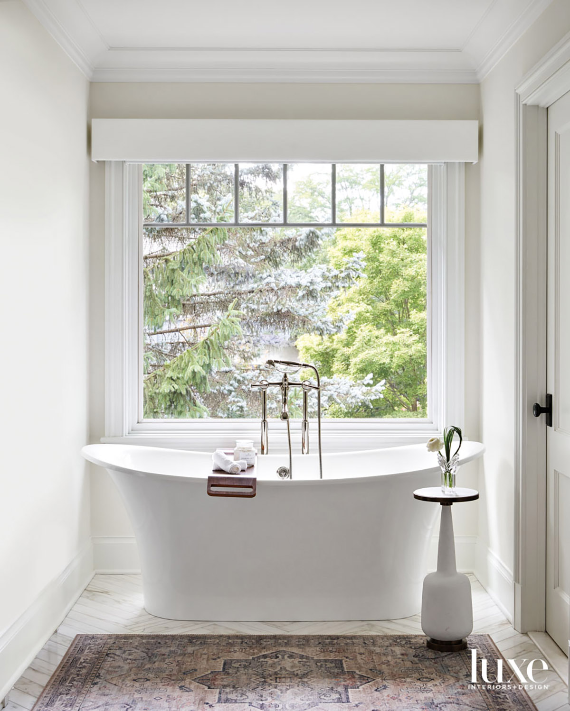 A standalone bathtub in a...